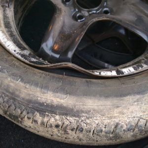 An example of a bent wheel rim caused by hitting a pothole.